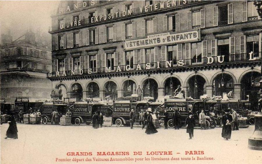 Delivery trucks await their loads for the suburbs of Paris. For inner-city deliveries horse and carriage was used.
